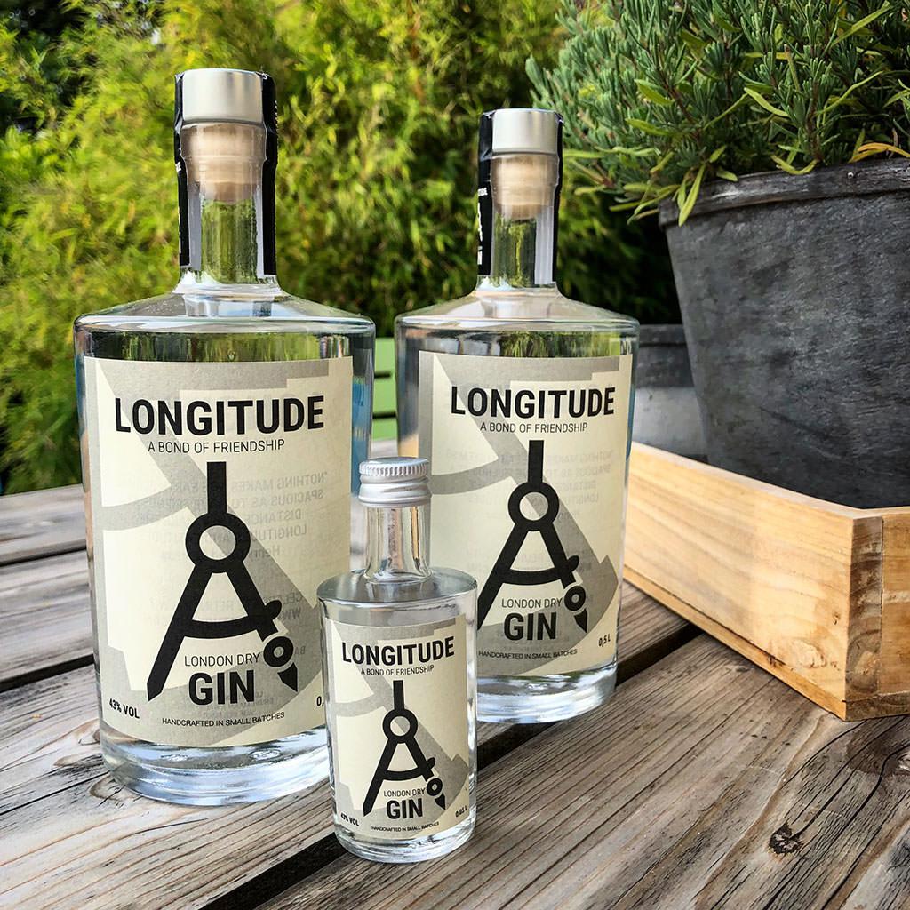 Photo showing Longitude Gin in three bottles