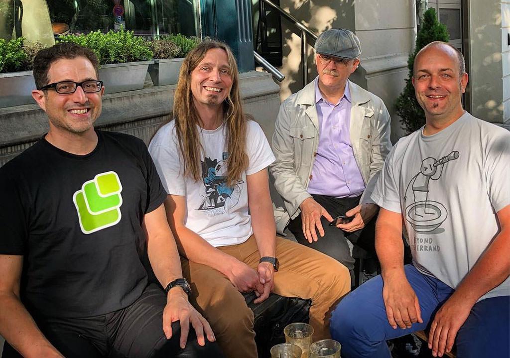 Photo showing Tantek, me, David and Joschi in Berlin. All smiling.